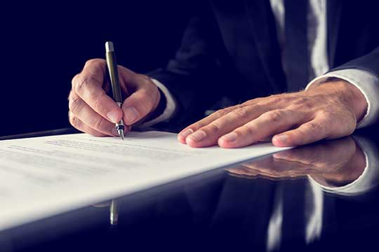 Notary Signing a legal Release or Waiver Agreement