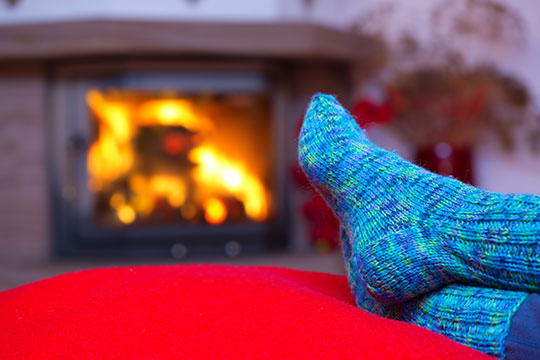 Relax by the fire on your holiday vacation.