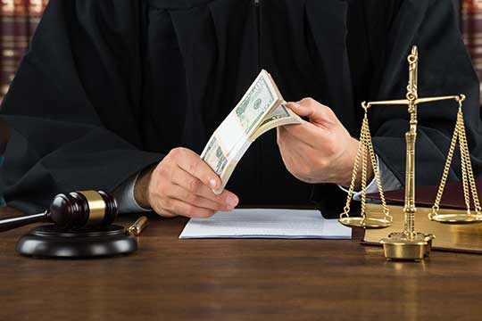 judge decides a court case holding money