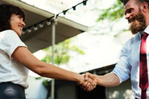 landlords shaking hands when giving landlord reference letter