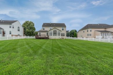 large yard and house in neighborhood purchased after transferring ownership of a deed and title