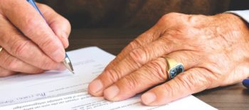 person signing different types of power of attorney forms